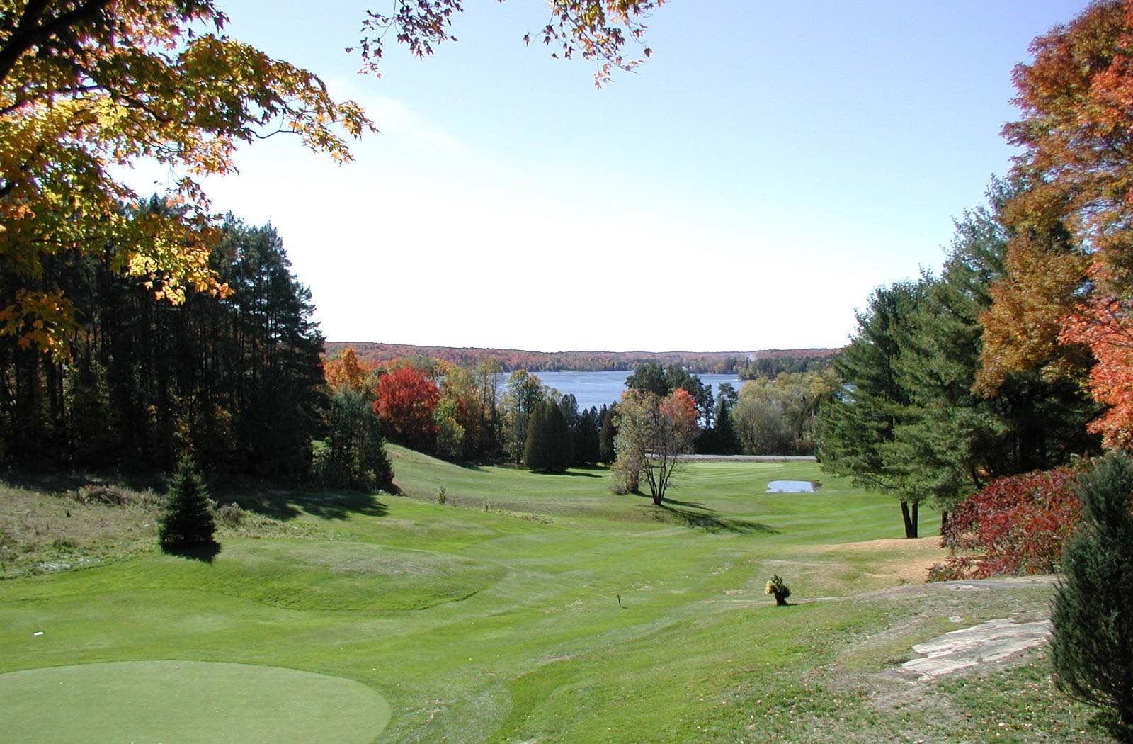Haliburton Highlands Golf Course with greens and lake in background
