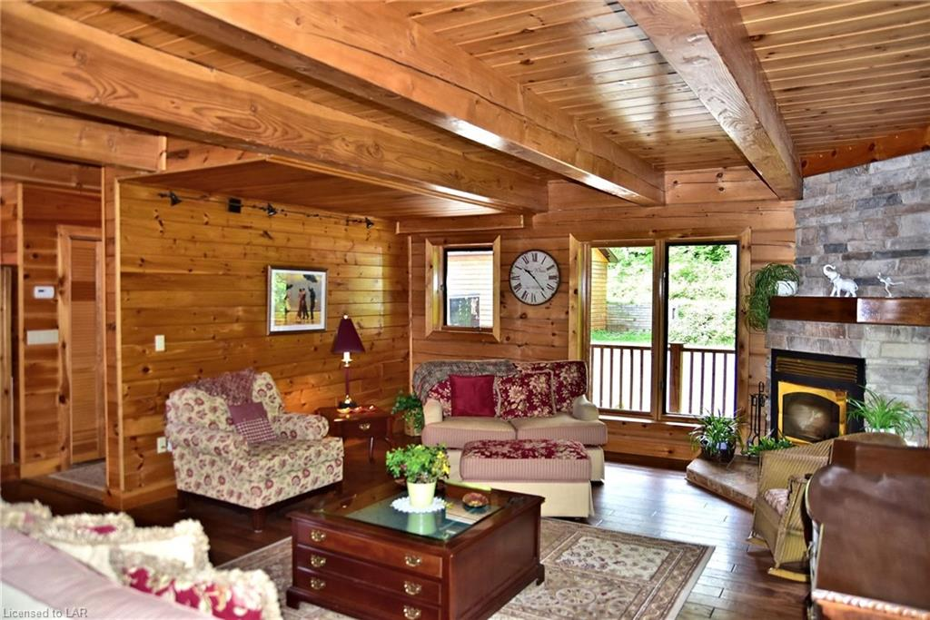 Living room of the Colbourne Lake Cottage log home