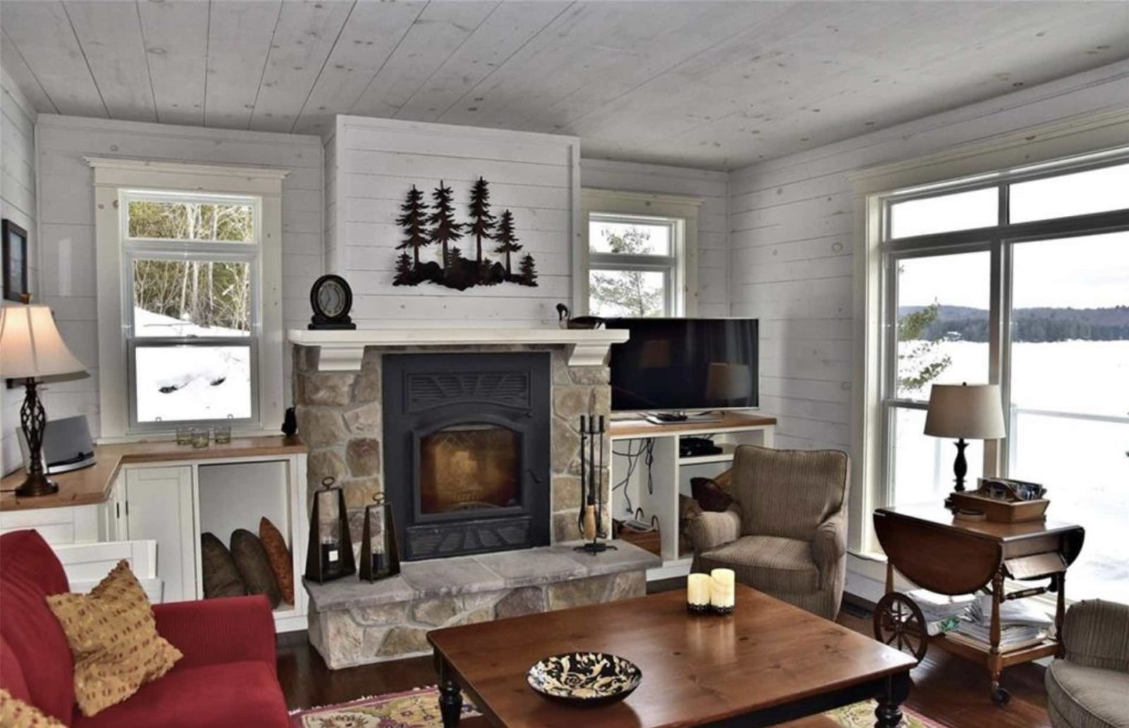 Kennisis Lake cottage interior showing living room and fireplace