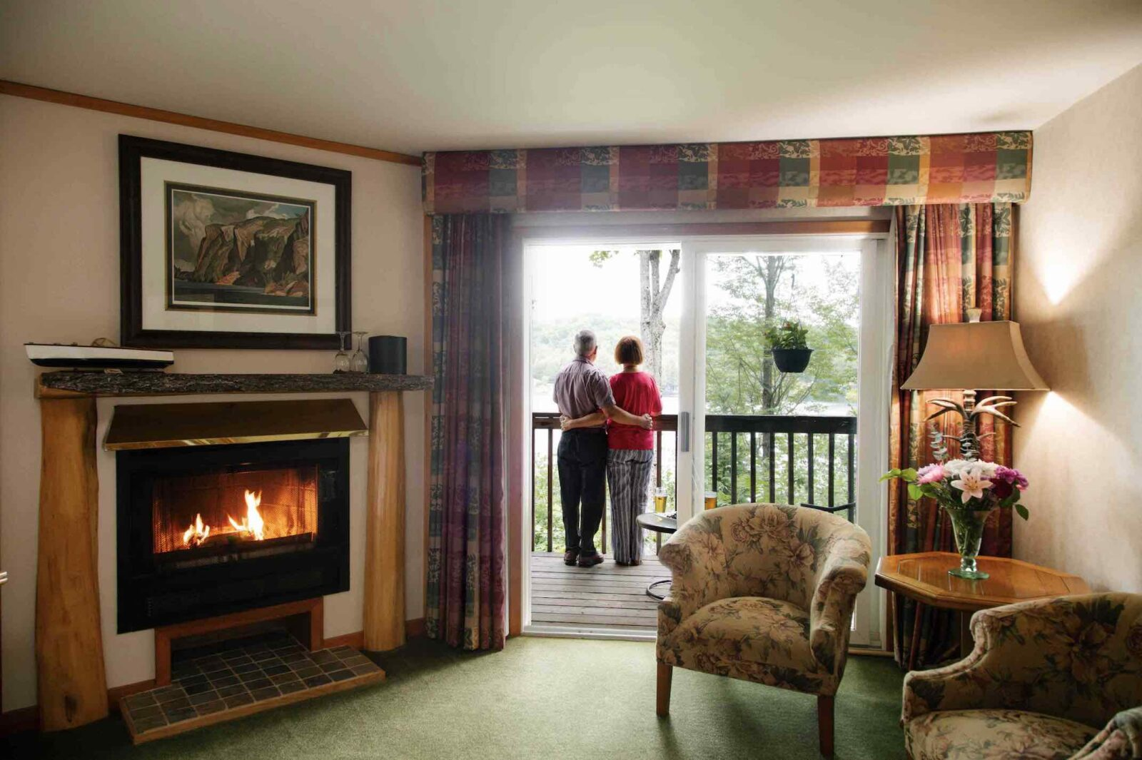Heather Lodge with couple standing on balcony looking at lake