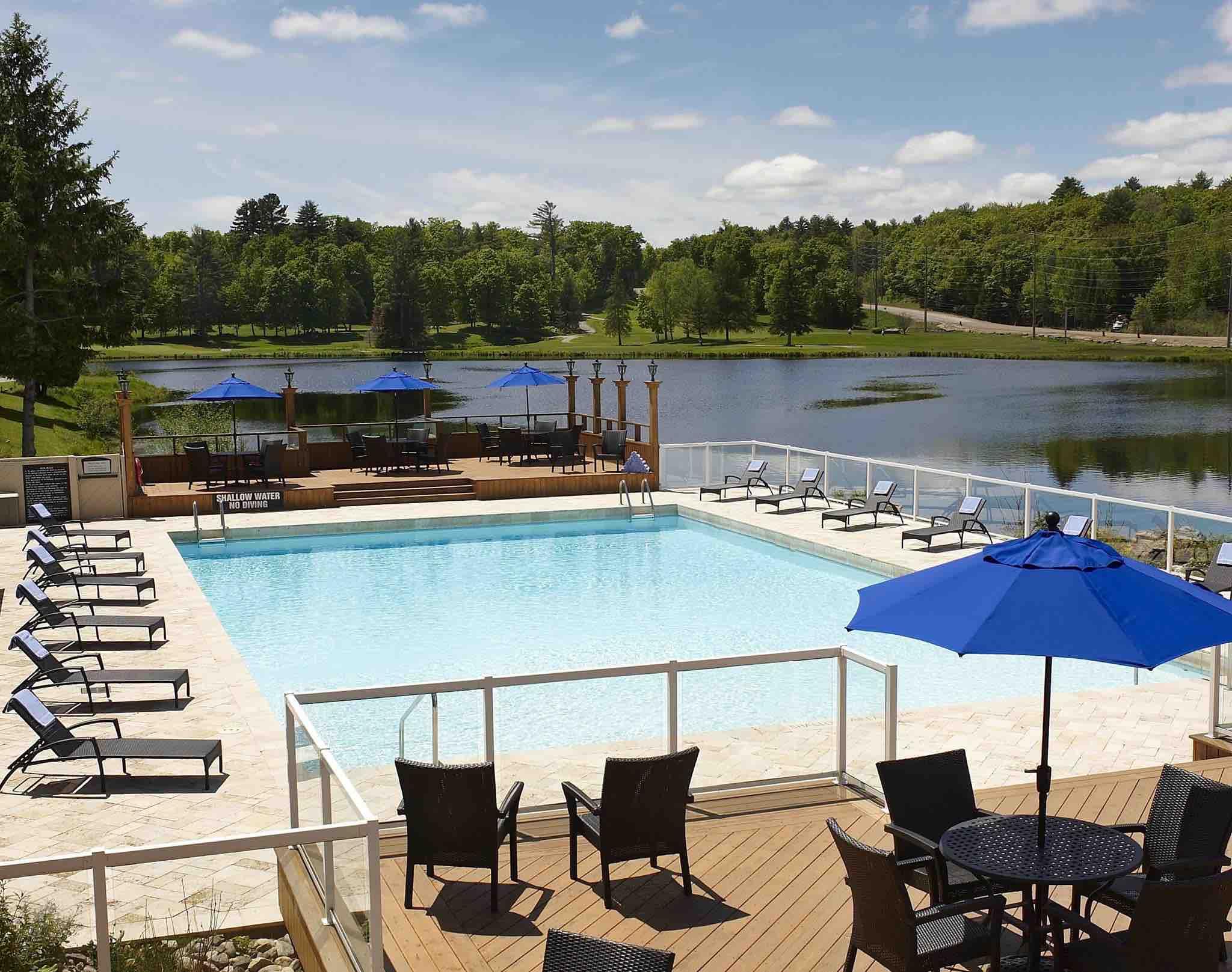 Pinestone Resort Haliburton Hotels swimming pool in summeer